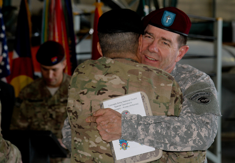 Photo of Chaplain Meverden hugging OEF veteran