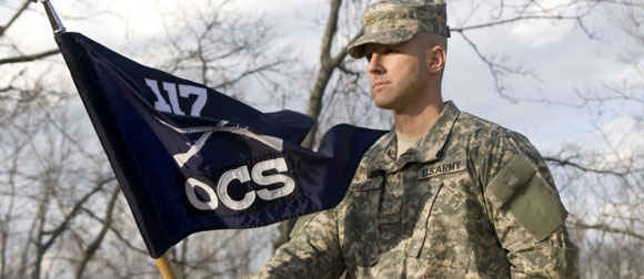 Image soldier carrying OCS flag